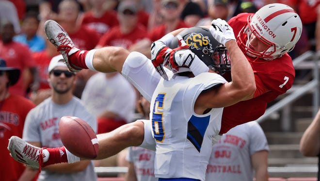 Dan Harrington tries to make a reception against St. Scholastica defender Rick Johnson during the Saturday, Sept. 3, game at Clemens Stadium in Collegeville.