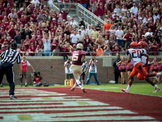 Travis Rudolph catches a 45-yard touchdown pass from