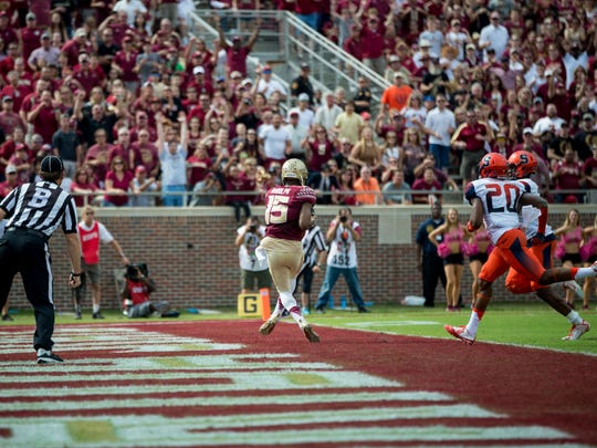 Travis Rudolph catches a 45-yard touchdown pass from Sean Maguire against Syracuse. Rudolph finished with 191 receiving yards and two touchdowns.
