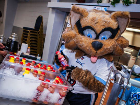 Tennessee Titans' mascot T-Rac helps hand out milk