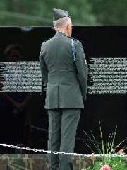 A man stares at The Moving Wall, a replica of the Vietnam