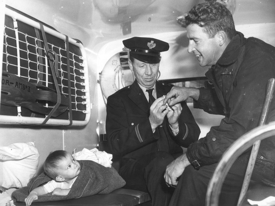 Richard Thomas, far right, helped pull this baby out of a fire while working as a firefighter with the San Francisco Fire Department.