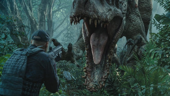"""This photo provided by Universal Pictures shows, Indominus Rex about to attack in a scene from the film, """"Jurassic World,"""" directed by Colin Trevorrow, in the next installment of Steven Spielberg's groundbreaking """"Jurassic Park"""" series. The movie grossed more than a half-billion dollars worldwide on its opening weekend."""