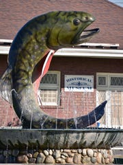 A large fiberglass Brook Trout is a centerpiece of downtown Kalkaska, Michigan Wednesday, Jluy 19, 2017. The village hosts an annual trout festival in late Apring each year, celebrating the popular fish. (Special to the Detroit News/John L. Russell)