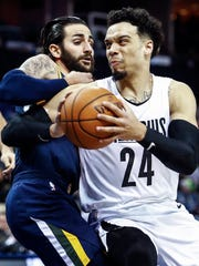 Memphis Grizzlies guard Dillion Brooks (right) drives