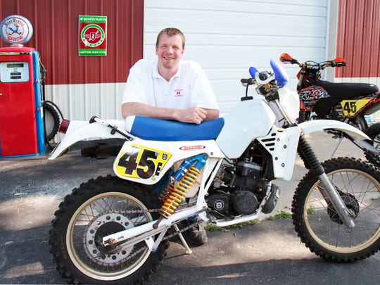 Former Pacers center Rik Smits poses with one of his vintage motocross motorcycles, a 1983 Husqvarna 430 cc, at his Zionsville, Ind. home in 2010.