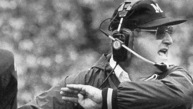 Michigan coach Bo Schembechler tries to alert his offense in the first quarter of their game against Minnesota in Ann Arbor on Nov. 10, 1984.