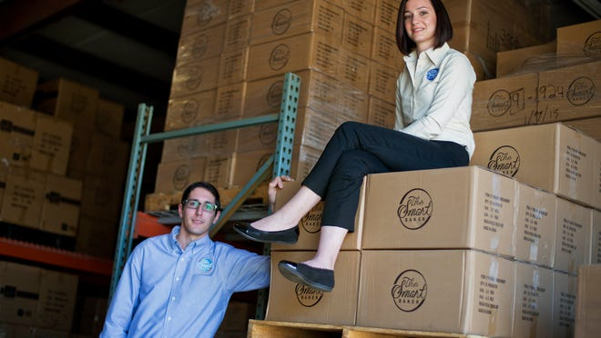 "Daniel Rensing, left and his wife Stephanie, owners of The Smart Baker, are photographed at their warehouse in Rockledge, Fla. Annual revenue for their company is close to $1 million, up from $130,000 before their March 2012 appearance on the reality TV show ""Shark Tank""."