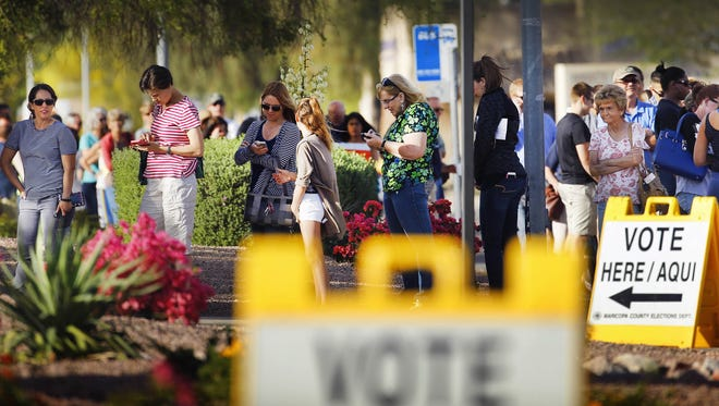 People wait in line to vote at Mountain View Lutheran Church on March 22,  2016, in Phoenix.
