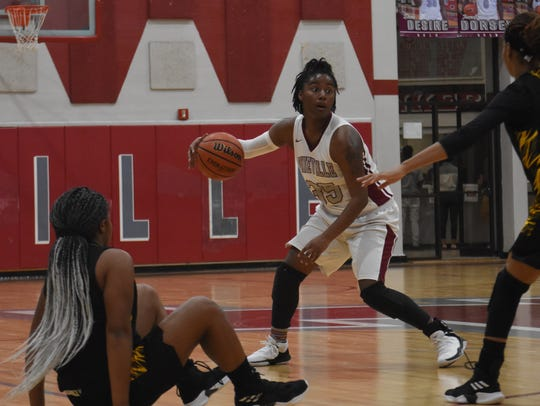 Pineville's Indiya Smith (35) looks to score against