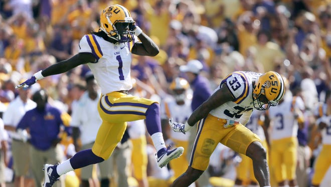 Louisiana State Tigers defensive back Donte Jackson (1) and safety Jamal Adams (33) react to a near interception against the Auburn Tigers in the second quarter at Tiger Stadium