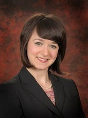 Erin Johnson is a real estate lawyer at Dickinson Wright PLLC in Troy.
