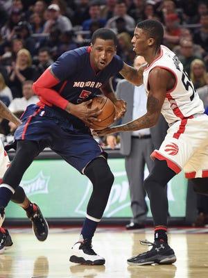 Pistons' Kentavious Caldwell-Pope drives around the Raptors' Delon Wright on Feb. 28.