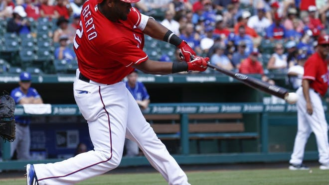 Texas Rangers' Hanser Alberto connects for an RBI-double against the Kansas City Royals during the seventh inning of a baseball game, Sunday, July 31, 2016, in Arlington, Texas. (AP Photo/Jim Cowsert)