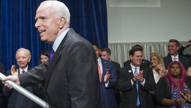 Sen. John McCain, R-Ariz., walks in to give his victory speech to his supporters during his campaign party at the Heard Museum in Phoenix on Nov. 8, 2016.
