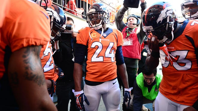 The Broncos huddle with cornerback Champ Bailey (24) before their playoff win over the San Diego Chargers last week.