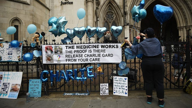 Supporters of of terminally ill baby Charlie Gard protest outside the High Court after the verdict was announced on July 24, 2017 in London, England.926