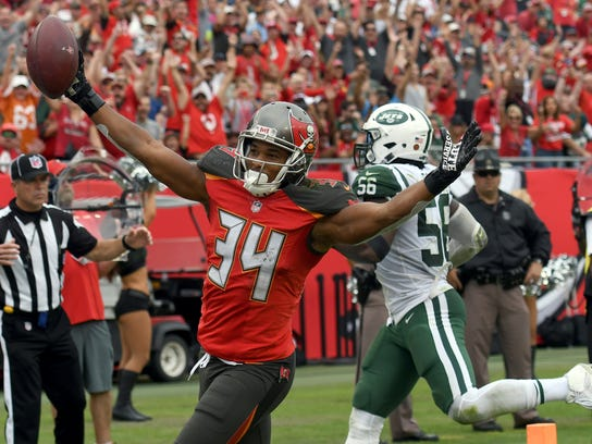 Tampa Bay Buccaneers running back Charles Sims (34) celebrates after scoring on a 6-yard touchdown pass against the New York Jets during the second half of an NFL football game Sunday, Nov. 12, 2017, in Tampa, Fla. (AP Photo/Jason Behnken)