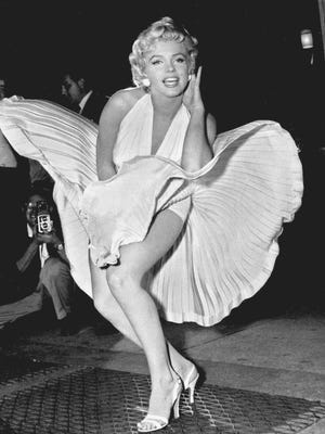 """Marilyn Monroe  as a Soviet agent? That?s the premise  of The Blonde. ORG XMIT: CAPH128 FILE - In this Sept. 9, 1954 file photo, Marilyn Monroe poses over the updraft of New York subway grating while in character for the filming of """"The Seven Year Itch"""" in Manhattan. The former Norma Jean Baker modeled and starred in 28 movies grossing $200 million. Sensual and seductive, but with an air of innocence, Monroe became one of the world's most adored sex symbols. She died alone by suicide, at age 36 in her Hollywood bungalow.  (AP Photo/Matty Zimmerman, File)"""