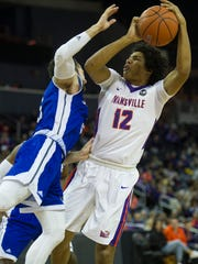 University of Evansville's Dru Smith (12) takes a shot over Drake's Graham Woodward (3) at the Ford Center on Saturday, Jan. 27, 2018. The Purple Aces defeated the Bulldogs 77-73.