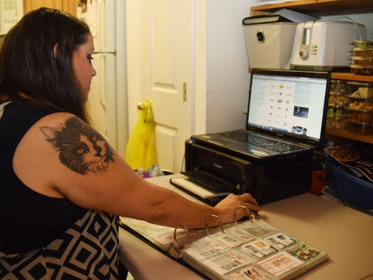Michelle Abbott searches CouponMom.com for coupons in her home in Fishkill.