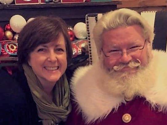 Melissa Say and Santa during Christmas