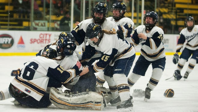 Essex celebrates at the conclusion of the Division I high school girls hockey championship between the Middlebury Tigers and the Essex Hornets at Gutterson Fieldhouse on Tuesday night.