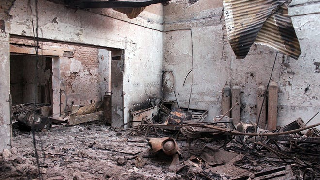 In this Oct. 16, 2015 file photo, the charred remains of the Doctors Without Borders hospital is seen after being hit by a U.S. airstrike in Kunduz, Afghanistan. Immediately after the U.S. killed at least 30 people in a devastating airstrike on a charity hospital, Afghanistan's national security adviser told a European diplomat that his country would take responsibility. It was convinced the hospital was occupied by Taliban.