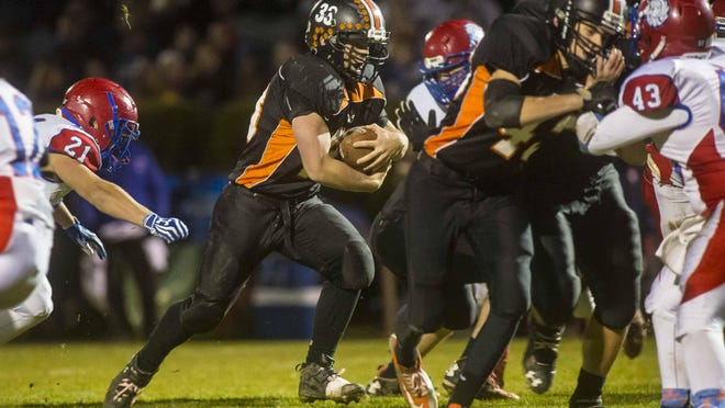 Middlebury's Cortland Fischer looks for room to run against Hartford during last week's Division I semifinal game.