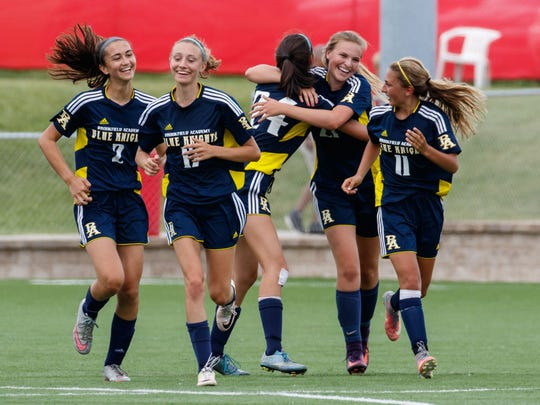 Brookfield Academy players celebrate after teammate Adrianne Koveck (second from right) scores a goal with less than five minutes to play in the WIAA Division 4 girls state soccer championship against Lake Country Lutheran at Uihlein Soccer Park in Milwaukee on Saturday, June 17, 2017. Brookfield Academy won the game 1-0.
