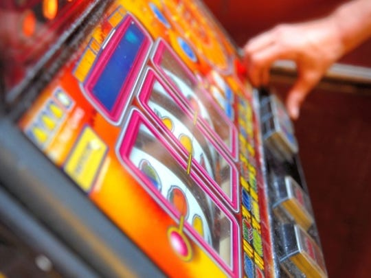 Adult playing on gambling machine