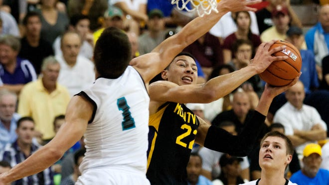 Montverde's Ben Simmons, center, shoots against Providence's Grayson Allen on Saturday during the City of Palms Classic at Bishop Verot High School in Fort Myers.