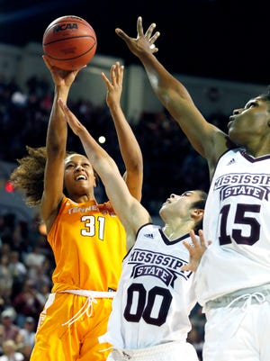 Tennessee guard Jaime Nared shoots over Mississippi State guard Dominique Dillingham (00) and center Teaira McCowan in the second half of Sunday's game in Starkville, Miss. Tennessee won 82-64.