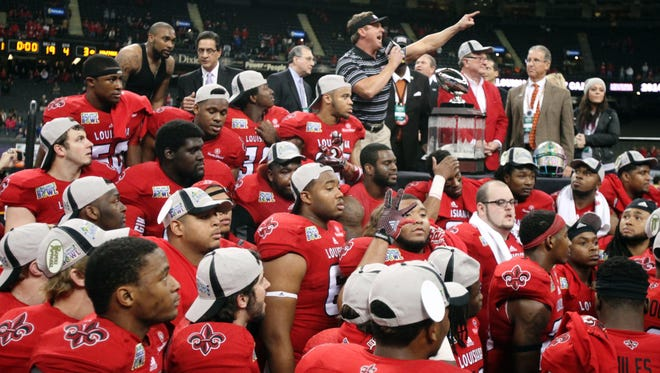 UL and coach Mark Hudspeth, seen here after 2014 New Orleans Bowl win over Nevada, have no postseason ban hanging overhead after a favorable NCAA ruling.