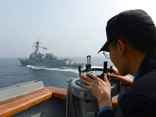 In this photo provided by South Korean Defense Ministry, a South Korean navy sailor watches the destroyer USS Wayne E. Meyer during a joint exercises between the United States and South Korea in South Korea's West Sea Tuesday, April 25, 2017. South Korea's military said Tuesday that North Korea held major live-fire drills in an area around its eastern coastal town of Wonsan as it marked the anniversary of the founding of its military.
