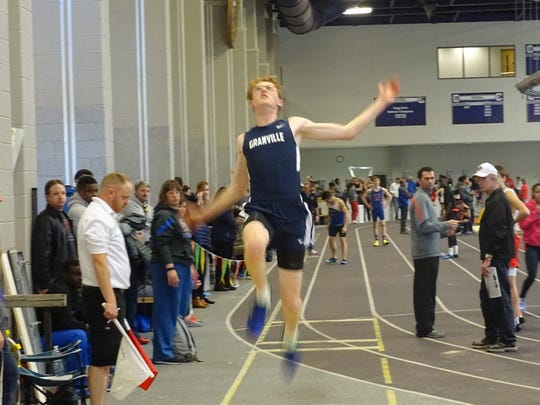 Granville senior Forrest Lee competes in the long jump Sunday during the Division I Central District Indoor meet. Lee is qualified to the state meet in the triple jump.
