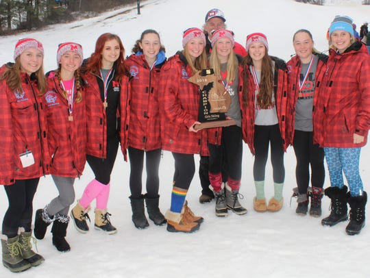 The Milford girls ski team is all smiles after winning