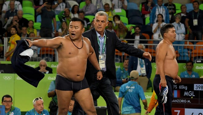 Coaches from Mongolia thought their wrestler, Mandakhnaran Ganzorig, had won his match. When a ruling went against him they protested. Vociferously. p