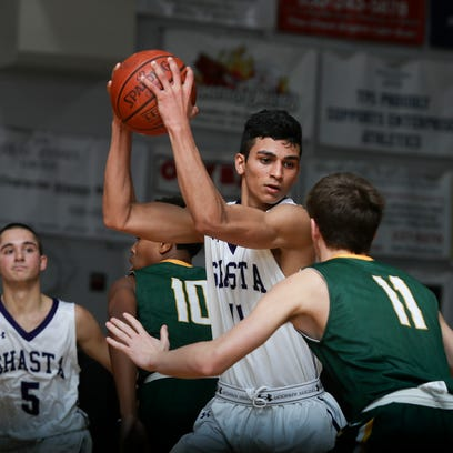 Shasta High's Simer Singh (center) keeps the ball from