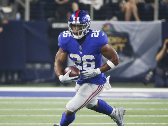 New York Giants running back Saquon Barkley (26) carries the ball during the first half of an NFL football game against the Dallas Cowboys in Arlington, Texas, Sunday, Sept. 16, 2018. (AP Photo/Michael Ainsworth) ORG XMIT: TXSO1