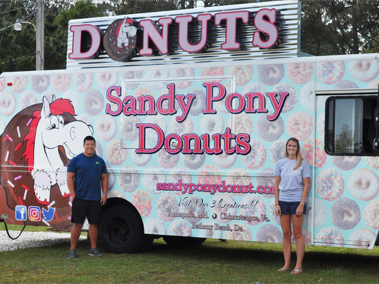 Ben Wang and Brea Reeves at their new donut truck in