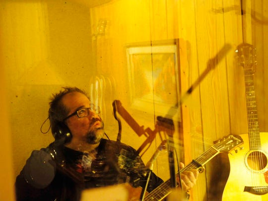 Jim Reilley sings in the booth while in the studio