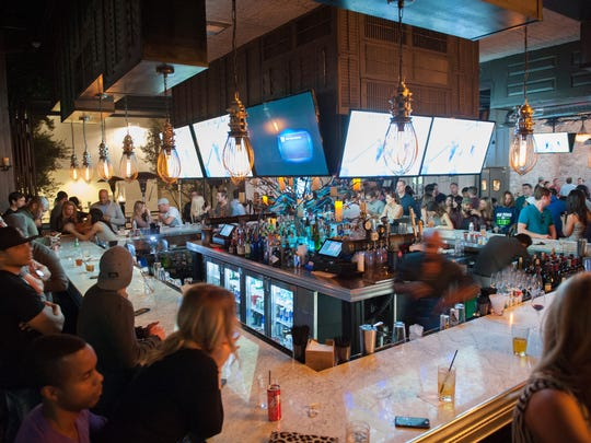 Lots of televisions make a great view of the game possible from just about anywhere in the house at Dakota Bar in Scottsdale on Sunday, Jan. 18, 2015.