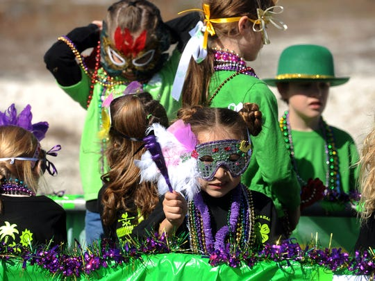 Kids get ready for a previous Navarre Krewe of Jesters Mardi Gras parade. The 34th annual parade gets underway Saturday.