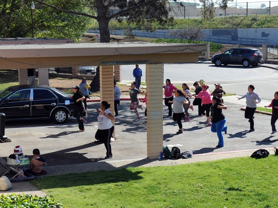 Residents of Acosta Plaza participate in Zumba class.
