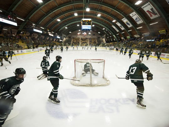 The teams warm up before the start of the Division II high school boys hockey championship between Stowe and U-32 at Gutterson FieldhHouse on Monday night.