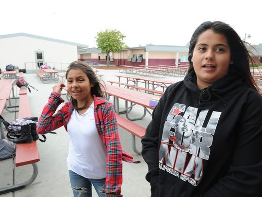 Gavilan View MIddle School students Victoria Amezcua, left, and Kayleen Ruelas outside the bathroom at where they found $10,700 in cash.