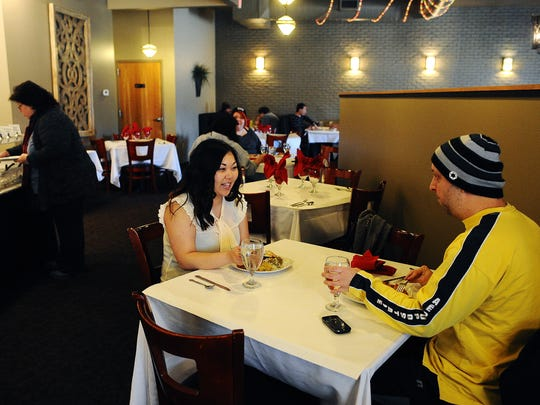 Michelle Harwood and her brother, Kyle Harwood, both of Sioux Falls, have lunch  at Shahi Palace.