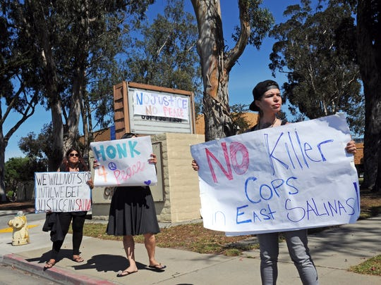 Protestors outside Sherwood Hall on Thursday during a press conference about advancing improvements in police-community relations in Salinas.