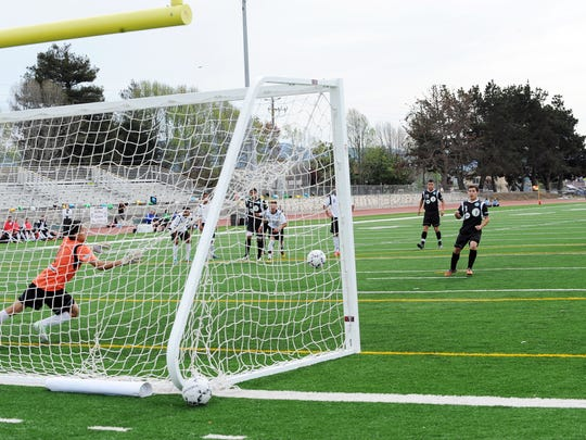 Stingray player Sergio Javier makes good on a penalty kick versus the Wind during The Salinas Californian All-Star Classic soccer game at Alisal High School on Sunday.